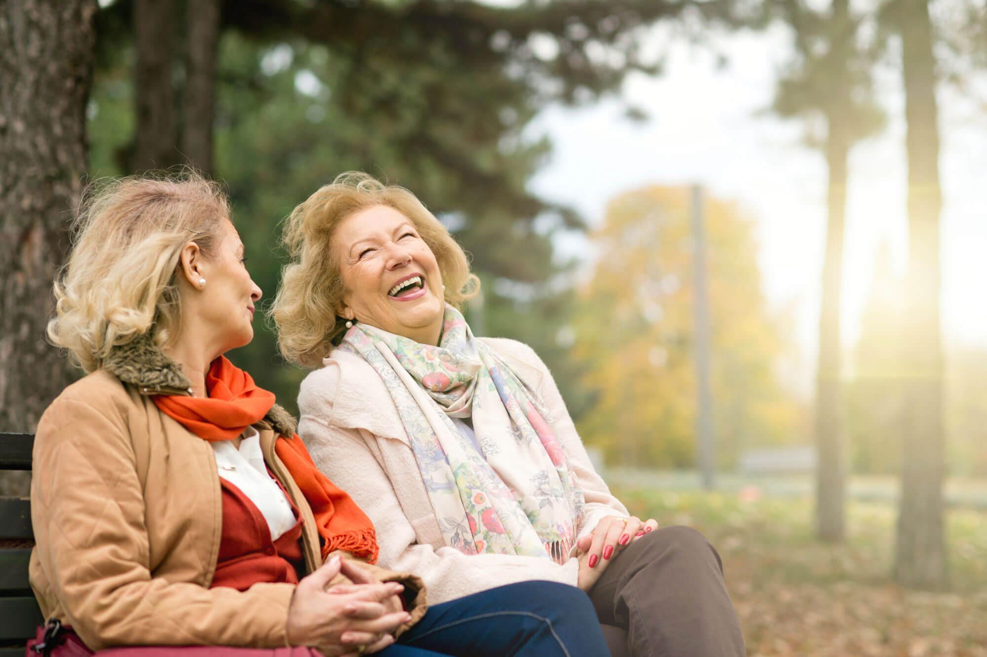 Two senior people enjoying time outside.